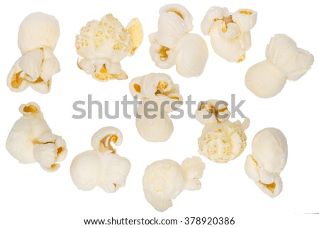 Scattered popcorn isolated on white. Close up shot. - stock photo