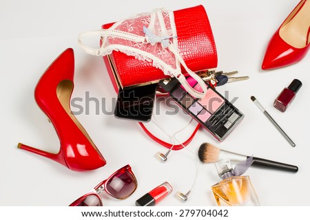 Scattered shoes, accessories, cosmetics and underwear.Set of stylish girl. - stock photo