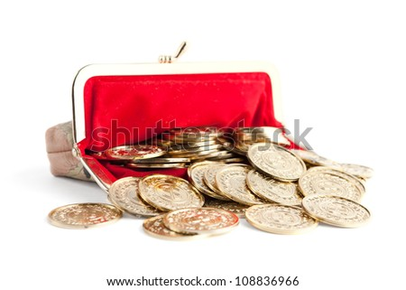 Scattered silver and gold coins are in hot red purse, isolated on white background. A great number of coins symbolize wealth, richness, income and profit. Close up shot. - stock photo