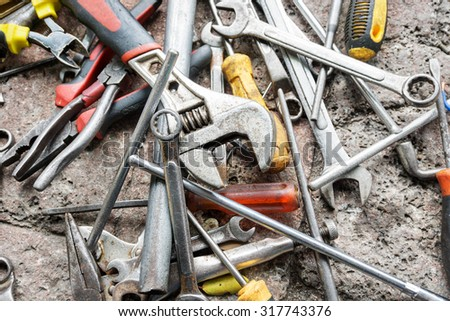 scattered spanners and screwdrivers on the ground - stock photo