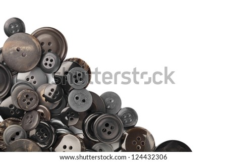 Scattered vintage buttons collection on a white background - stock photo