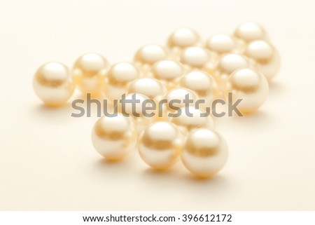 Scattering white pearls on white background as decoration