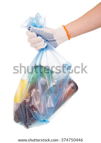 Scavenging, hand holds a full garbage bag with household waste isolated on white background - stock photo