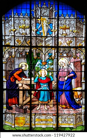 SCEAUX, FRANCE - OCTOBER 7: Stained glass windows depicting the St. Family of Nazareth at St. Jean-Baptiste Church on October 7, 2012 in Sceaux.