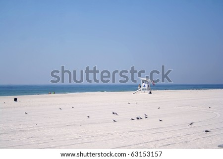 Scene from Beach at Gulf Shores, Alabama, USA, at end of summer with Life Guard Stand. - stock photo