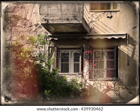 scene from old houses with bullet holes that have been destroyed from the Second World War. (now is shelter for homeless and immigrants). Photo in old image style.