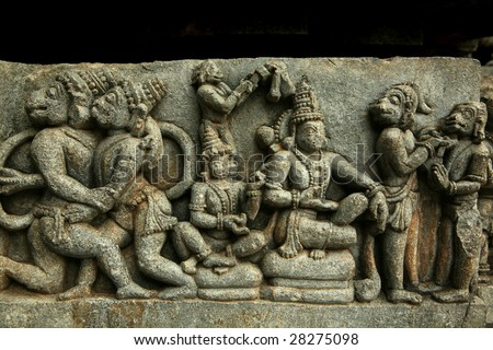 Scene from Ramayana carved in stone - masterpiece of Hoysala art. Halebid temple. India - stock photo