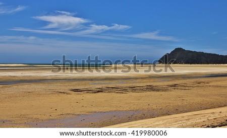 Scene in the Abel Tasman national Park, New Zealand. Sandy beach. - stock photo
