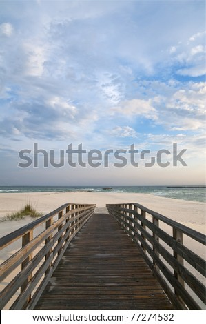 Scene of a walkway leading to the beach at Orange Beach AL. - stock photo