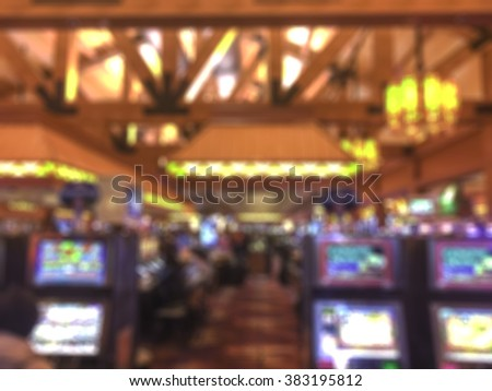 scene of people play slot machines in casino -blurred picture - stock photo