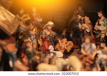 Scene where Virgin Mary has given birth to Jesus and he is laying in cradle surrounded by people who came to celebrate nativity of Christ - stock photo