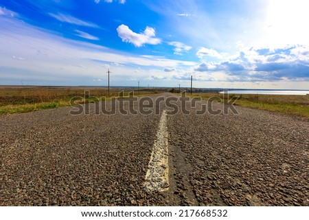 Scene with asphalt countryside road - stock photo