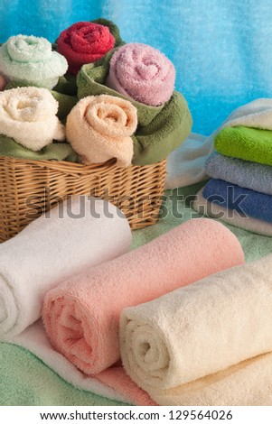 Scene with towels in the form of flowers. - stock photo