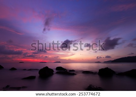 Scenery of beach during twilight with magenta color  - stock photo