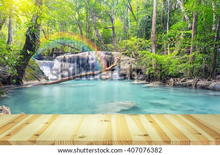 Scenery of Erawan waterfall with wood floor. - stock photo