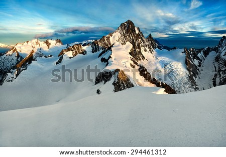 scenery of high mountain with snow and high peak - stock photo