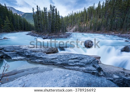 Scenery of high mountain with Sunwapta Falls, Jasper National Park, Alberta, Canada - stock photo