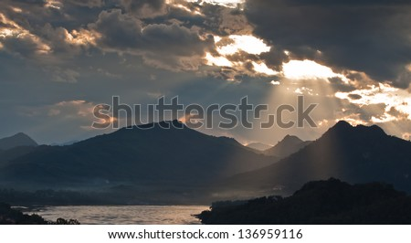 Scenery Of Mountain with River and Cloudy Sky. - stock photo