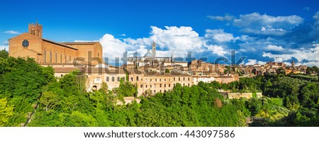 Scenery of Siena, a beautiful medieval town in Tuscany, with view of the Dome & Bell Tower of Siena Cathedral (Duomo di Siena), landmark Mangia Tower and Basilica of San Domenico,Italy   - stock photo