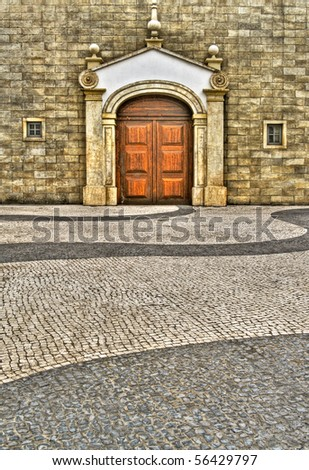 Scenery of street with old style buildings and wall and ground. - stock photo