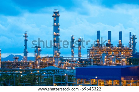 Scenery of the petrochemical plant in the evening time in the industrial zone  - stock photo