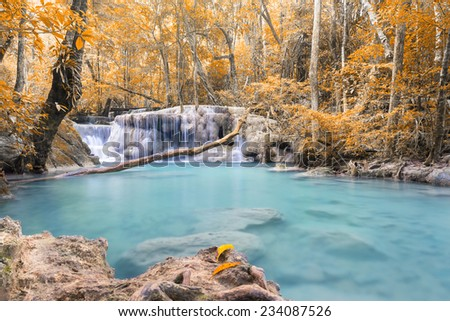 scenery of waterfall, beige leaf and blue water. - stock photo