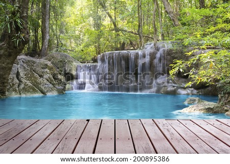 Scenery of Waterfall with wood deck. - stock photo