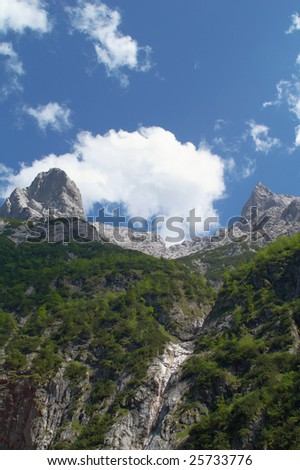 Scenery shot in Alpine mountains, two peaks and cloud - stock photo