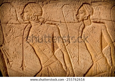 Scenes of nubian prisoners in low-relief at the entrance of the Abu-Simbel Temple (Egypt) - stock photo