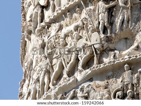 scenes of war and many Romans warriors  sculpted in Trajan's column in Rome - stock photo
