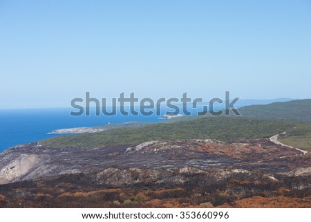 Scenic aerial panoramic coastal view of Torndirrup National Park, Albany, Western Australia, burnt vegetation, Southern Ocean, blue sky, copy space. - stock photo