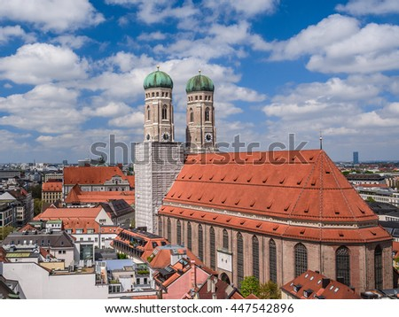 Scenic aerial panoramic view of the Old Town architecture - Munich cathedral church Frauenkirche under blue sky with clouds, Munchen, Bavaria, Germany