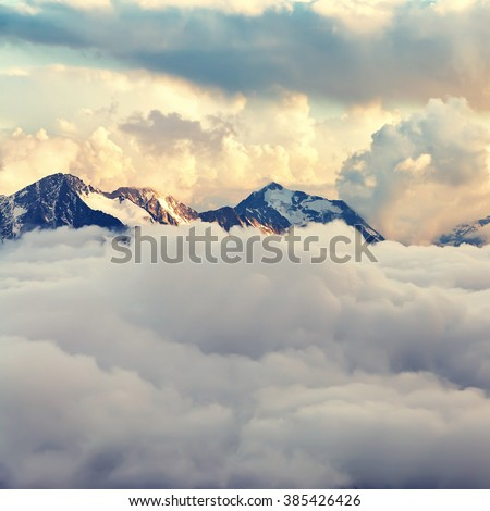 scenic alpine landscape with mountain ranges. natural mountain background. vintage stylization - stock photo