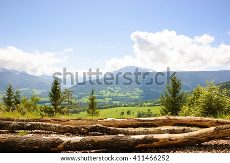 Scenic alpine view with cut logs at foreground. Annecy lake area (Haute-Savoie, France). - stock photo