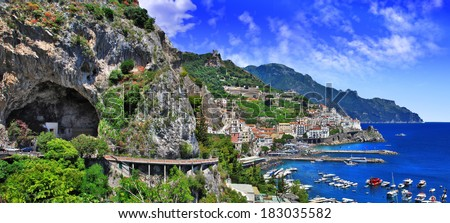 scenic Amalfi coast, view with cave and serpantine road - stock photo