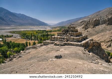 Scenic ancient ruins on the ridge in Pamir mountains in Tajikistan - stock photo