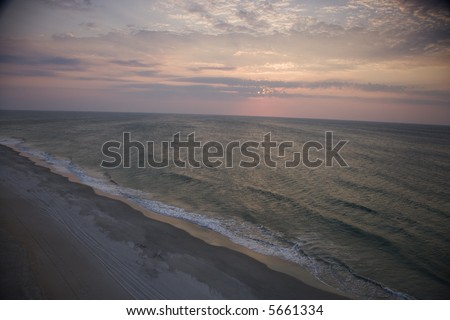 Scenic Bald Head Island North Carolina landscape of shoreline during sunrise. - stock photo