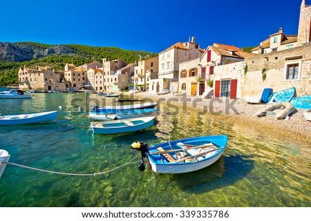 Scenic beach in Komiza village waterfront, Island of Vis, Croatia - stock photo