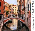 Scenic canal with bridge, Venice, Italy - stock photo