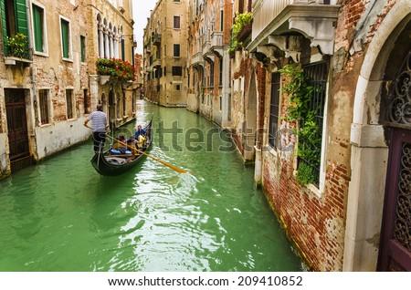 Scenic canal with gondola, Venice, Italy  - stock photo