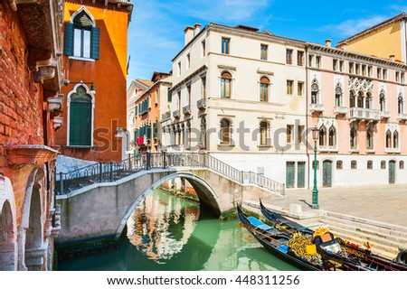Scenic canal with gondolas and colorful buildings in Venice, Italy