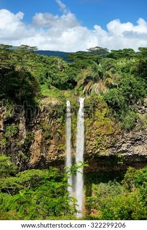 Scenic Chamarel falls in jungle of Mauritius island - stock photo
