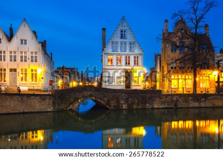 Scenic city view of Bruges canal with beautiful medieval colored houses and reflections, Belgium - stock photo
