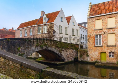 Scenic cityscape of the Green canal, Groenerei, and bridge in Bruges, Belgium - stock photo