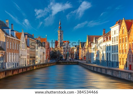 Scenic cityscape with canal Spiegelrei and Jan Van Eyck Square in the morning in Bruges, Belgium - stock photo