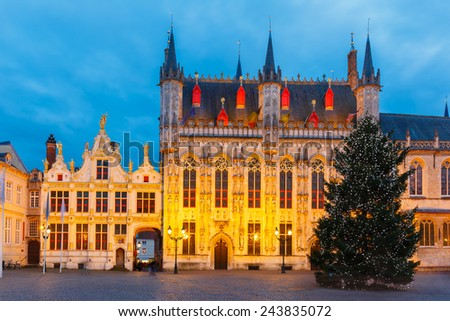 Scenic cityscape with the picturesque night medieval Christmas Burg Square in Bruges, Belgium - stock photo