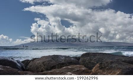 Scenic clouds over the beautiful Hawaiian Island of Lana'i - stock photo
