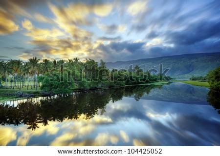 Scenic Etang Saint Paul river at dawn, Reunion Island. - stock photo