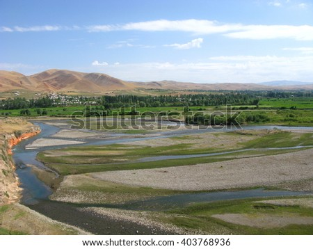 Scenic farming area in the valley of Kyrgyzstan.   - stock photo