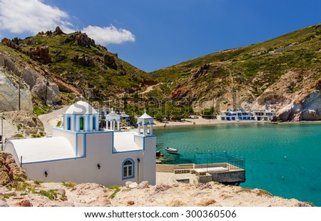 Scenic Firopotamos village (traditional Greek village by the sea, the Cycladic-style) with sirmate - traditional fishermen's houses, Milos island, Cyclades, Greece. - stock photo